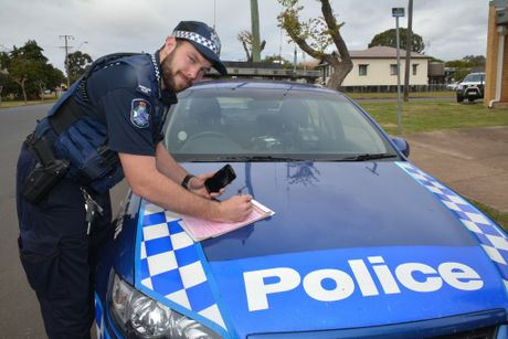 Kingaroy Police Constable Carl Stevenson joins with Queensland police to say enough is enough and drivers need to put down their mobile phones. Photo Kate Darvall/ South Burnett Times