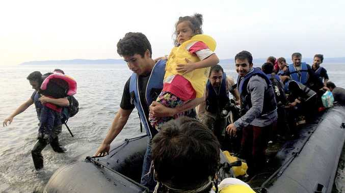 Refugees from Syria arrive at the coast of Mytilini, Lesvos island, on a dinghy after crossing from Turkey, on September 10, 2015. Some 3,000 refugees disembark daily at the coasts of the island, coming from the Turkish coastline.