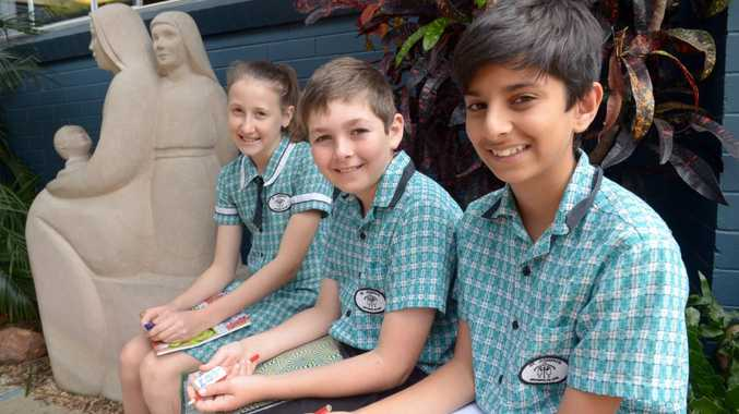 WRITE FEST: St Joseph's Catholic Primary School students Libby Dullaway, Zachary Christiansen and Bilal Tasawar recently went to a Writers Festival in Brisbane where they participated in workshops and got to meet some cool authors. Photo: Max Fleet / NewsMail