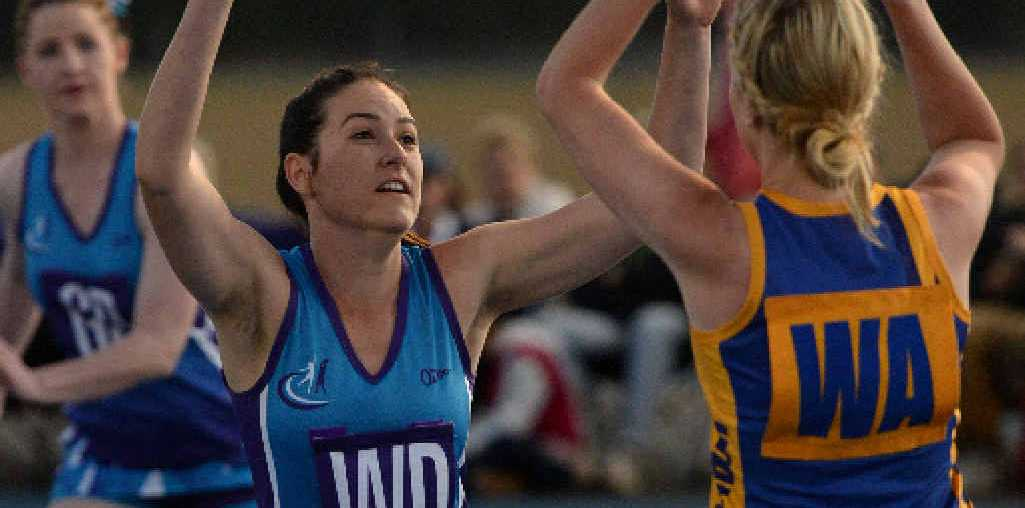 NETBALL FINAL: Alloway's Shona Philp and ATW Gold's Emma O'Beirne in the Division 1 netball grand final.