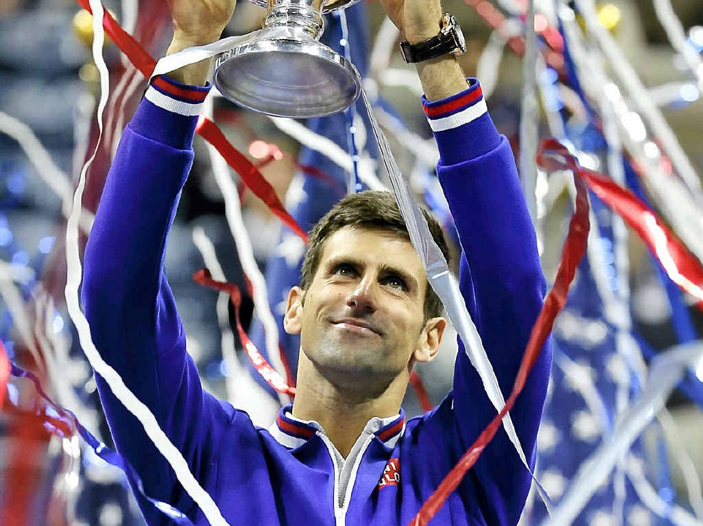NEW YORK STATE OF MIND: Novak Djokovic holds up the championship trophy after defeating Roger Federer in the US Open final.