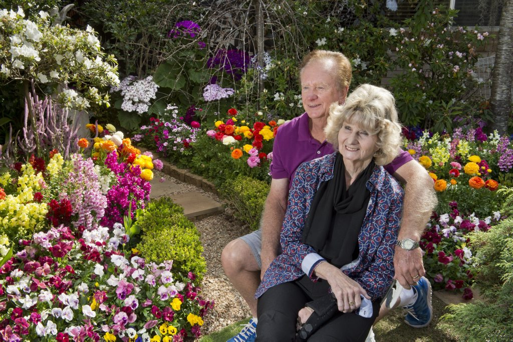 Bob and Val Ford in their 19 Burke St garden. The Chronicle Garden Competition . Carnival of Flowers 2015. Thursday, Sep 10, 2015 . Photo Nev Madsen / The Chronicle