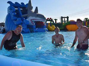 Sliding in for a splash on the world's highest inflatable