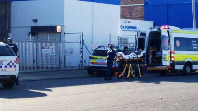 FATAL STABBING: Paramedics and police at the scene of the alleged stabbing at the Ozcare Homeless Hostel in Alma St. INSET: 32-year-old stabbing victim Aaron Flenady died from his injuries in hospital on Tuesday night.