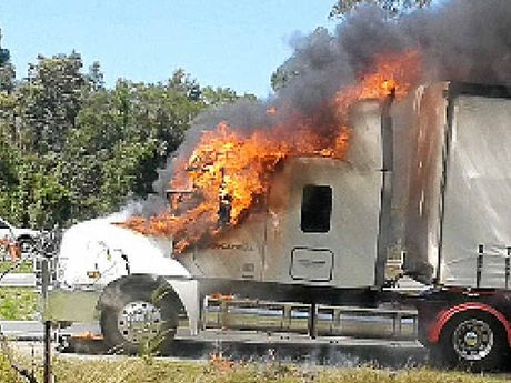 FIRE: Flames begin to erupt in the truck's cabin.