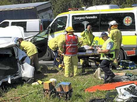 CUT FREE: A pregnant woman is taken to an ambulance.