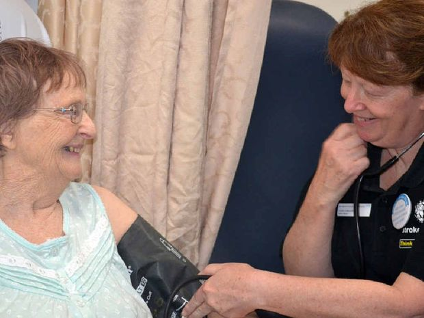 ON THE MEND: Ipswich Hospital's Linda Edwards performs a blood pressure check on Vivien Westbrook.