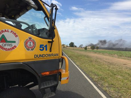 An exclusion zone has been set up as fire crews battle strong winds and flames that have completely engulfed a shed believed to contain chemicals on Lower Mountain Road in Dundowran.