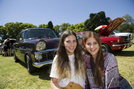 Carnival of Flowers 2013 In front of the 1961 Holden EK Special is Bianca Bate (left) and Chloe Hill at the Carnival Classic Cars in Queens Park, Saturday, September 21, 2013. Photo Kevin Farmer / The Chronicle