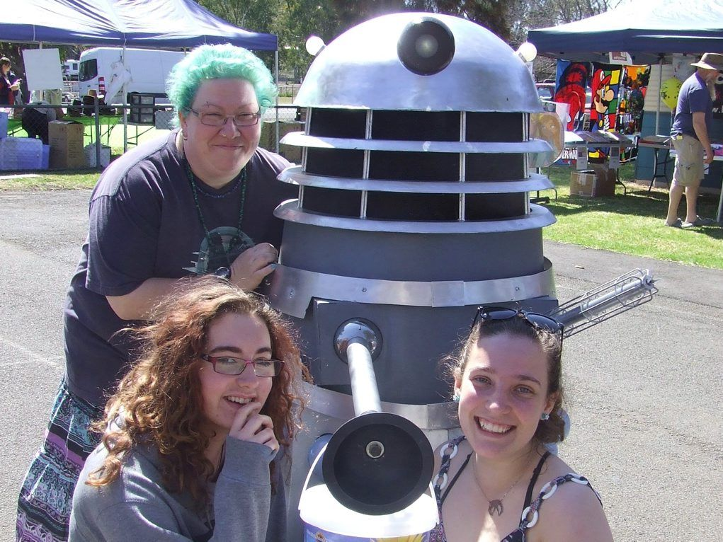 Kaitlyn Bott and Ella Gartery met crowd favourite Dalek 'Ky' with 'minder' Rhiannon Clark at Sundays Spring Fair at the Allora State School.