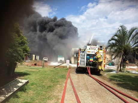 Queensland Fire and Rescue Service crews at the scene of a shed fire in Dundowran.