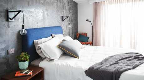 Kingi and Caro's guest bedroom with rendered feature wall.