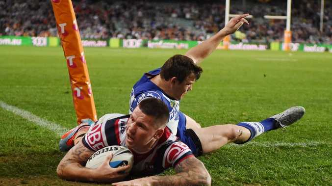 Shaun Kenny-Dowall of the Roosters scores the opening try during the first NRL Semi Final between the Sydney Roosters and the Canterbury-Bankstown Bulldogs at Allianz Stadium in Sydney, Friday, Sept. 18, 2015. (AAP Image/Dean Lewins) NO ARCHIVING, EDITORIAL USE ONLY