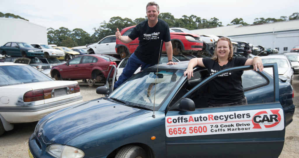 HAVE WE GOT A CAR FOR YOU? Russell and Rhonda Klenk pay a visit to a Coffs Harbour car wrecking yard to check out the standard of car they might be driving in the Mystery Box Rally.