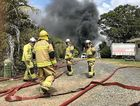 HEROES: Queensland Fire and Rescue Service crews work to put out a blaze at a shed in Dundowran.