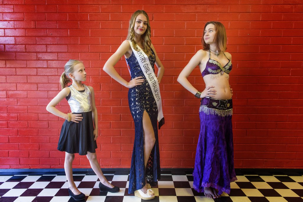 Britany Smidt, 8 and sisters Claire and Jess Smidth strike a pose after their success in the recent Miss Country Girl competition in Grafton. Photo Adam Hourigan / The Daily Examiner