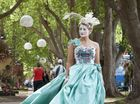Emily Martin models fashion from Carolyn Taylor-Smith as part of the Culture to Couture event during the Ergon Energy Flower, Food and Wine Festival.