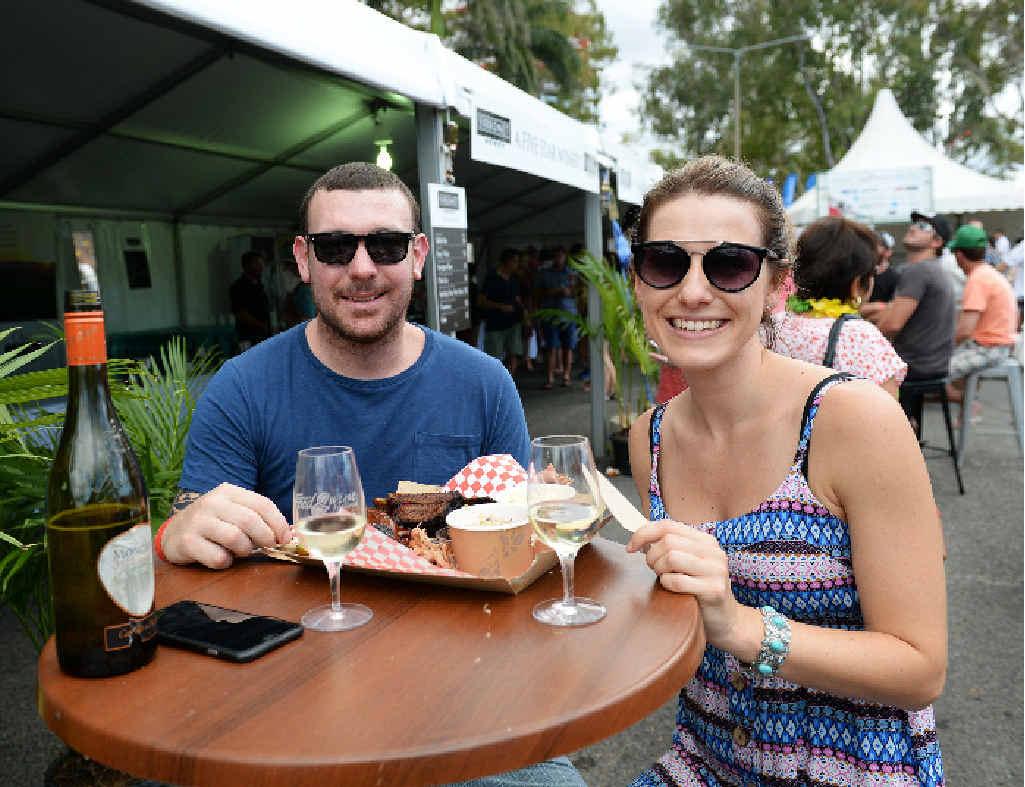 INDULGING: Luke McNamara and Candy Burndred enjoy the Capricornia Food and Wine Festival.