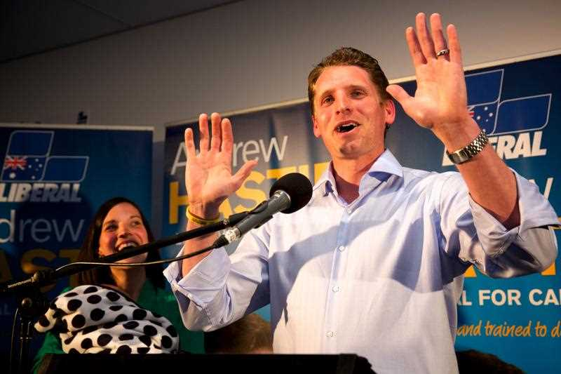 Australian Liberal candidate for Canning Andrew Hastie with his wife Ruth Hastie (left) holding their son Jonathan gives a speech after winning the Canning by-election at the Pinjarra Bowling Club Western Australia on Saturday Sept. 19, 2015.