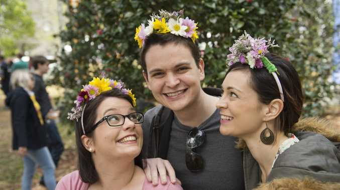 Having fun are (from left) Ellen, Byron and Natalie Kustjens at the Ergon Energy Flower, Food and Wine Festival in Queens Park.