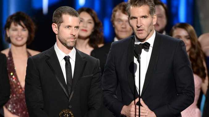 D.B. Weiss, left, and David Benioff accept the award for outstanding drama series for Game Of Thrones at the 67th Primetime Emmy Awards.