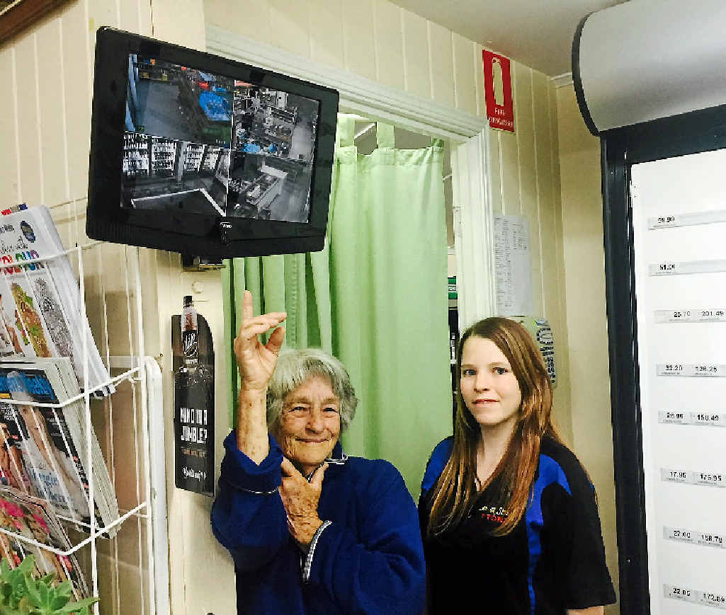 SCARY: Mary Dale and Tamara Muller show the new CCTV system at the Lennox St Store. Two of Tamara's fellow employees were threatened at knifepoint on Sunday. ABOVE LEFT: A still from the CCTV footage that shows the man holding the knife.