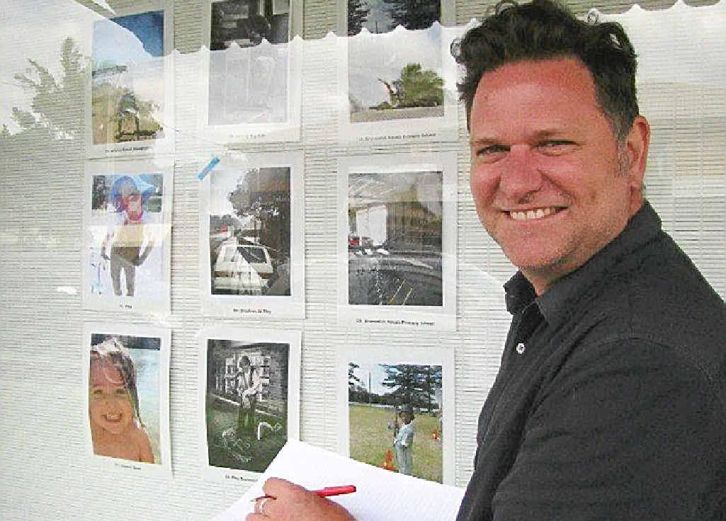 HARD CHOICE: Byron Shire mayor Simon Richardson enjoying the Simple Pleasure Photo Competition exhibition in Brunswick Heads.