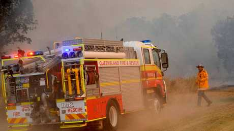 Rural Fire Services fight a blaze south of Sarina on Friday night.