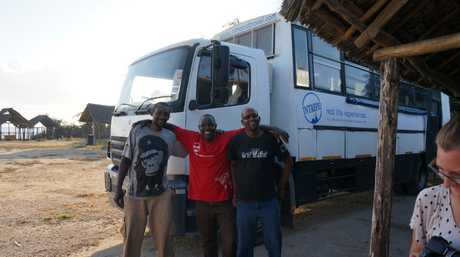 Intrepid tour leader Julius Leteele (right) during an overland trip through East Africa. Pictured with the cook and driver. Contributed photo: By Rae Wilson