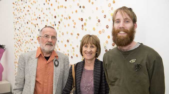 Christopher Hardwick with Andrea Lowrie and Andrew Lowrie. Andrew is one of the artists.