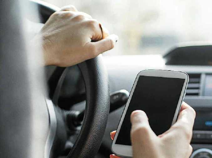RISKING LIVES: A truck driver's declaration he counted 600 plus drivers using mobile phones between Toowoomba and Brisbane is disturbing.
