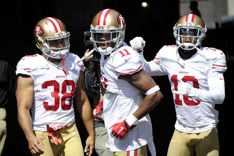 San Francisco 49ers running back Jarryd Hayne (38) wide receiver Quinton Patton (11) and wide receiver DeAndrew White (18) take the field forwarms up before an NFL football game against the Pittsburgh Steelers, Sunday, Sept. 20, 2015 in Pittsburgh.