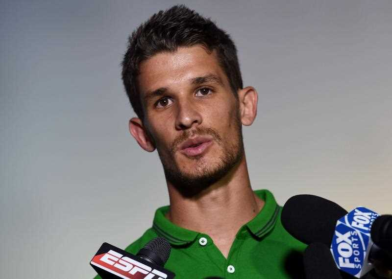 Australia's forward Dario Vidosic gives an interview after a press conference in Vitoria on June 10, 2014, as they prepare for the 2014 FIFA World Cup in Brazil.