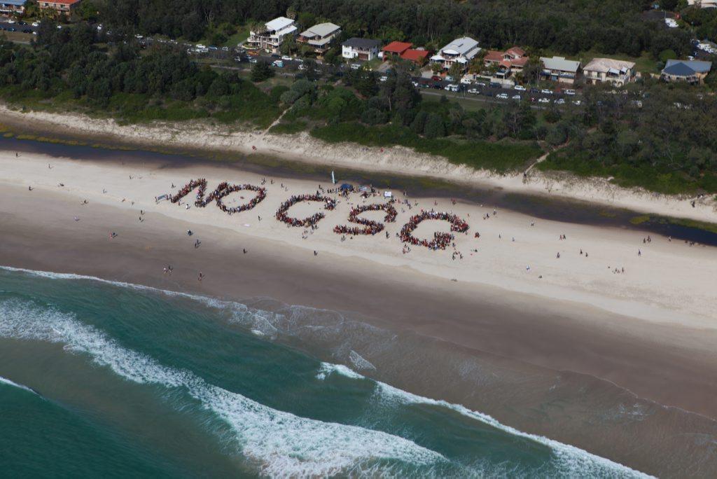2000 gather on Byron Bay's beach to protest Coal Seam Gas mining. Photo Jim