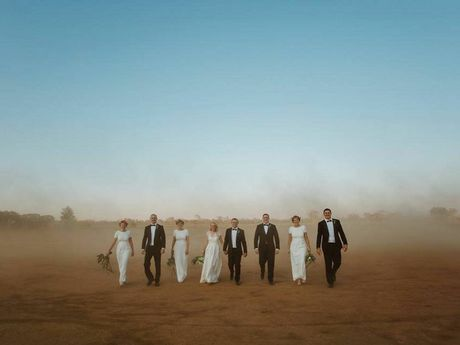Edwina Robertson's photo of a wedding in Blackall went viral and has raised more than $16,000 for charity.
