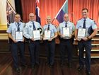 THANK YOU: Snr Sgt Wayne Tinknell, Act Sgt Christopher Helsdon, Snr Con Shannon Spinks, Snr Con Scott Chambers and Con Riley Cozens stand proudly with their awards of service and bravery.