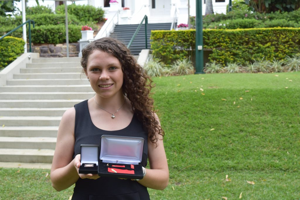 Meghan Krogh accepted a bravery award on behalf of her father Peter Krogh. Mr Krogh helped save the life of a man caught in floodwater. Photo: Geoff Egan / APN Newsdesk