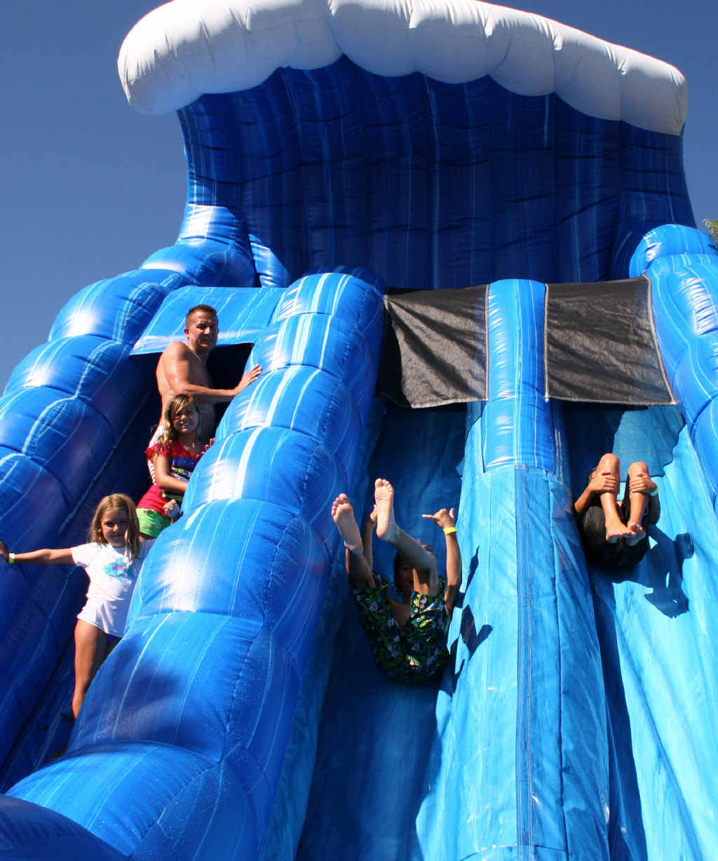 SPLASH DOWN: The Blue Crush Waterslide at Top Shots is the perfect way to keep cool these school holidays.