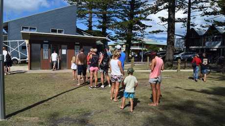 NO VACANCY: Waiting outside the toilets at Main Beach Byron Bay.