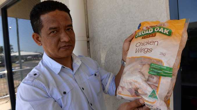 FOWL SMELL: Pranaya Gurung is unhappy with the bag of chicken wings which he purchased from a local supermarket. Photo: Mike Knott / NewsMail