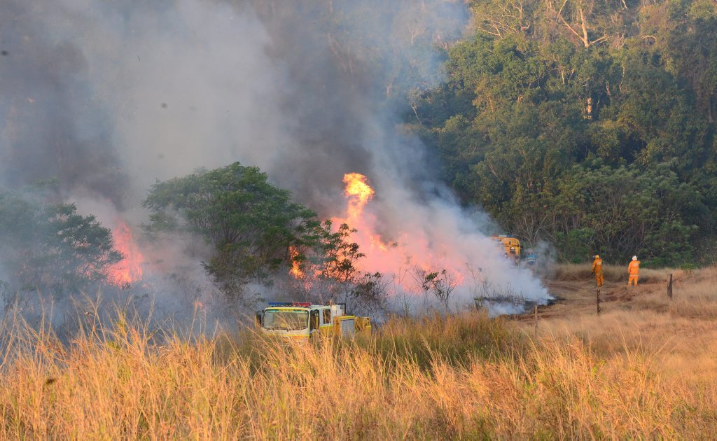 The Caves Rural Fire Service battles a bushfire off Camoo Caves Rd which was threatening houses Photo Rachael Conaghan/The Morning Bulletin