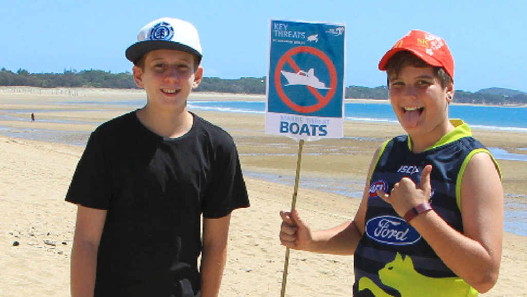 LEARNING: Roydan Wood and Oscar Seholer enjoy hearing about the reef at Bucasia Beach.
