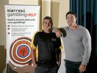 Harry Beckers and Nathan Hindmarsh visit the South Tweed Bowls club to raise awareness of the dangers of gambling in the indigenous community. Photo: Nolan Verheij-Full / Tweed Daily News