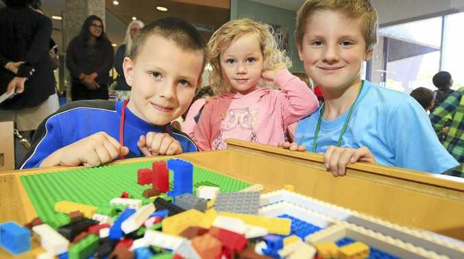 Nathan Cousin (7), Sophie Cousin (3) and Connor Sutherland (8) have fun at the Tweed Heads Library Lego Exhibition event. Photo: Scott Powick, Daily News.