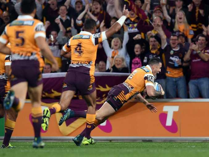 WHAT A START: Darius Boyd crosses for the Broncos' first try after just one minute.