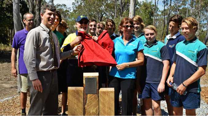 PROUD MOMENT: Tannum Sands State High School students celebrate their work with CQUniversity Construction teacher Ric Lane (hi-vis shirt), Todd Comrie (purple) and Owen Nevin (grey).