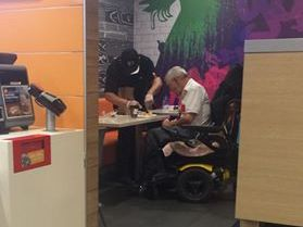 McDonald's employee helps disabled customer eat his food