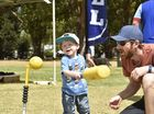 Testing his softball skills at the Carnival of Flowers 2015: Kids Day Out in Queens Park