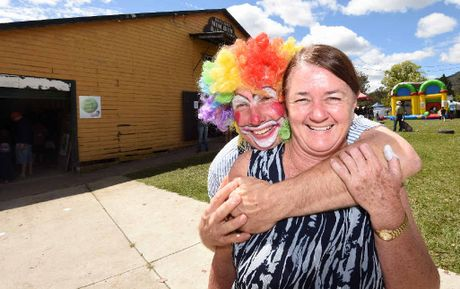 Janice Rose is congratulated after being awarded the life member badge at the Nimbin Country Show.
