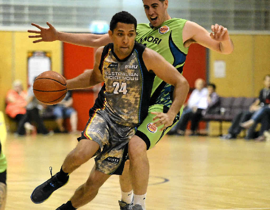 Mick Cedar tries to get around a New Zealand Maoris opponent.